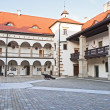 Niepolomice Castle courtyard - Stock Photo