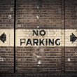 No parking sign on old brick wall — Stock Photo