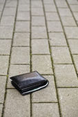 Lost black wallet — Stock Photo