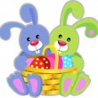 Blue and green easter rabbits with basket — Stock Vector #10505950