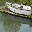 Small skiff with vintage motor — Stock Photo