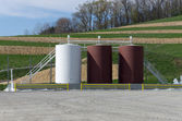 Storage tanks on a gas well site — Stock Photo