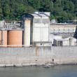 Industrial facility on river — Stock Photo