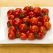 Royalty-Free Stock Photo: Red cherry tomatoes on white plate