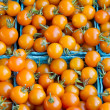 Stock Photo: Orange cherry tomatoes in boxes