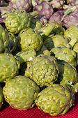 Artichokes on display at the farmers market — Stock Photo