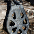 Stock Photo: Vintage cable pulley for logging