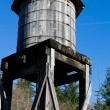 Stock Photo: Old wooden water tower under blue sky