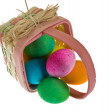 Stock Photo: Easter basket spilling dyed eggs