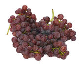 Fresh red seedless grapes isolated on white — Stock Photo
