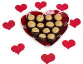 Heart shaped plate with hearts and buckeye cookies — Stock Photo