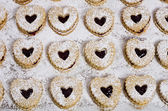Heart shaped cookies with strawberry jam — Stock Photo