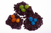 Three candy bird nests with jelly beans — Stock Photo