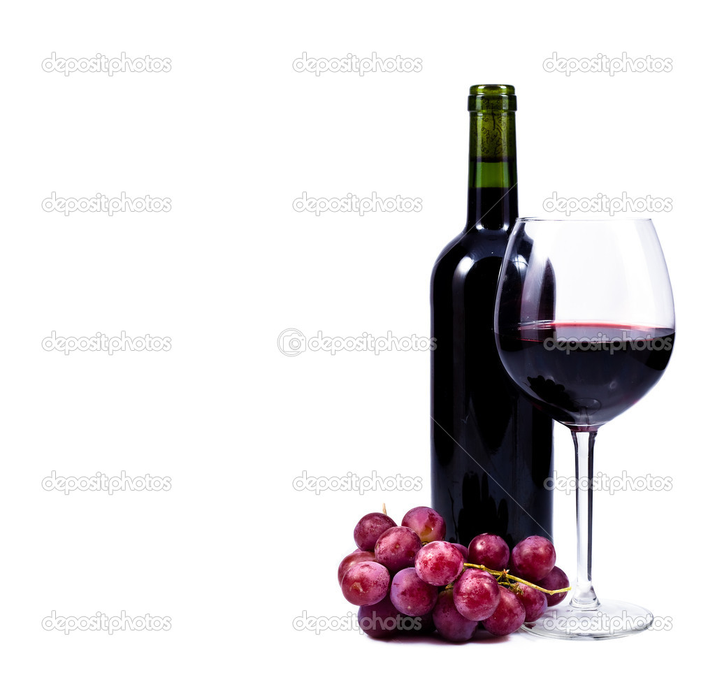 Wine glass with red wine, bottle of wine and grapes ...
