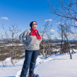 Stock Photo: Snowshoeing woman