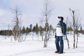 Snowshoeing woman — Stock Photo