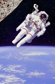 Astronaut floating in space — Stock Photo