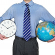 Stock Photo: Businessman with a Clock and the Globe