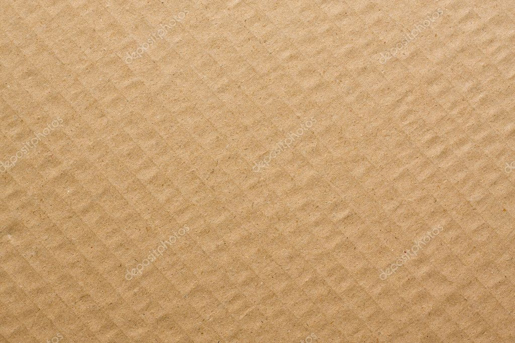 Brown corrugated cardboard useful as a background.  Stock Photo #10198763