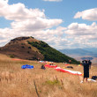 Stock Photo: Preparation for enjoyment. Paragliding in Macedonia.