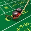 Shooting craps or dice on green felt background - Stock Photo
