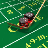 Shooting craps or dice on green felt background — Stock Photo