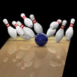 Bowling a strike on black background — 图库照片
