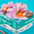 Royalty-Free Stock Photo: Flowers in a glass dish with slices of fish