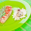 Fish with sesame on a green plate - Stock Photo