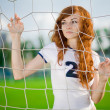 Healthy beautiful girl with freckles on soccer field — Stock Photo