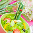 Bowl with a salad on the table — Stock Photo