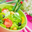 Bowl with a salad on the table — Stock Photo #9824226