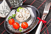 Vegetarian meal on the dish in a restaurant — Stock Photo