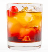 A delicious glass of whiskey with ice cubes and cherry — Stock Photo