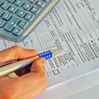 Stock Photo: Income tax calculation
