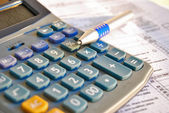 Tax calculator and pen — Stock Photo