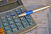 Tax calculator and pen — Stock Photo