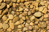 Pebble stone round rock texture — Stock Photo