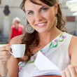 Young woman is sitting in the cafe — Stock Photo #10668112