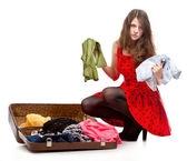 Young teenage girl with an opened suitcase — ストック写真