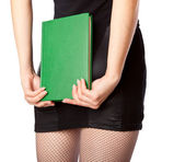 Woman in miniskirt is holding the book — Stock Photo