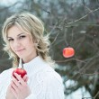 Stock Photo: Smiling young woman with red apple