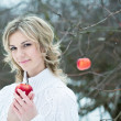 Stock Photo: Smiling young womwith red apple