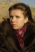 A girl in a fur coat with a scarf — Stock Photo