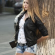 Girl with long hair in shorts — Stockfoto
