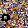 Stock Photo: Solitaire Diamond Surrounded By Colorful Gems