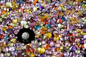 Solitaire Diamond Surrounded By Colorful Gems — Stock Photo