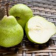 Group Of Fresh Pears With One Halved — Stock Photo
