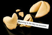 "Fortune cookie: ""Planning is the key to success."" — Stock Photo"