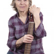 Elderly woman holding a guitar — Stock Photo #9321917